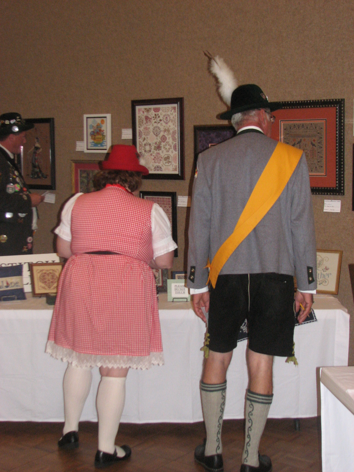 The La Crosse Oktoberfest Royal Family stops by the public library to check out the annual Oktoberfest Needlework Show.